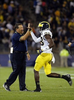 Sep 21, 2013; East Hartford, CT, USA; Michigan Wolverines head coach Brady Hoke greets quarterback Devin Gardner (98) after a touchdown in the third quarter against the Connecticut Huskies at Rentschler Field. Mandatory Credit: David Butler II-USA TODAY Sports