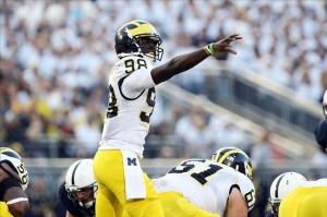 Oct 12, 2013; University Park, PA, USA; Michigan Wolverines quarterback Devin Gardner (98) signals during the second quarter against the Penn State Nittany Lions at Beaver Stadium. Mandatory Credit: Matthew O