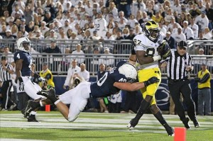 Oct 12, 2013; University Park, PA, USA; Michigan Wolverines tight end Devin Funchess (87) catches a pass in the end zone for a touchdown during the fourth quarter against the Penn State Nittany Lions at Beaver Stadium. Penn State defeated Michigan 43-40 in overtime. Mandatory Credit: Matthew O