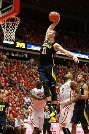 Nov 17, 2013; Ames, IA, USA; Michigan Wolverines guard Nik Stauskas (11) dunks the basketball against the Iowa State Cyclones at James H. Hilton Coliseum. Iowa State beat Michigan 77-70. Mandatory Credit: Reese Strickland-USA TODAY Sports