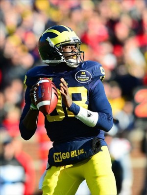 Nov 30, 2013; Ann Arbor, MI, USA; Michigan Wolverines quarterback Devin Gardner (98) looks to pass during the third quarter against the Ohio State Buckeyes at Michigan Stadium. Mandatory Credit: Andrew Weber-USA TODAY Sports
