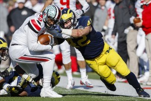 Nov 30, 2013; Ann Arbor, MI, USA; Ohio State Buckeyes quarterback Braxton Miller (5) is tackled by Michigan Wolverines linebacker Ben Gedeon (42) in the second quarter at Michigan Stadium. Mandatory Credit: Rick Osentoski-USA TODAY Sports