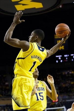 Jan 22, 2014; Ann Arbor, MI, USA; Michigan Wolverines forward Glenn Robinson III (1) goes to the basket in the first half against the Iowa Hawkeyes at Crisler Arena. Mandatory Credit: Rick Osentoski-USA TODAY Sports