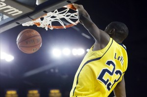 Jan 22, 2014; Ann Arbor, MI, USA; Michigan Wolverines guard Caris LeVert (23) dunks in the first half against the Iowa Hawkeyes at Crisler Arena. Mandatory Credit: Rick Osentoski-USA TODAY Sports