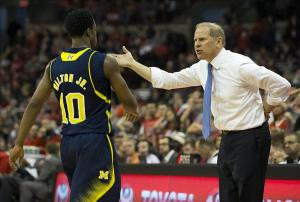 Feb 11, 2014; Columbus, OH, USA; Michigan Wolverines head coach John Beilein gives some instruction to guard Derrick Walton Jr. (10) in the game against the Ohio State Buckeyesat the Schottenstein Center. Michigan won the game 70-60. Mandatory Credit: Greg Bartram-USA TODAY Sports