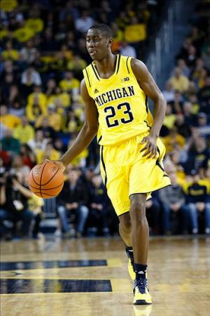 Feb 16, 2014; Ann Arbor, MI, USA; Michigan Wolverines guard Caris LeVert (23) dribbles the ball against the Wisconsin Badgers at Crisler Arena. Mandatory Credit: Rick Osentoski-USA TODAY Sports