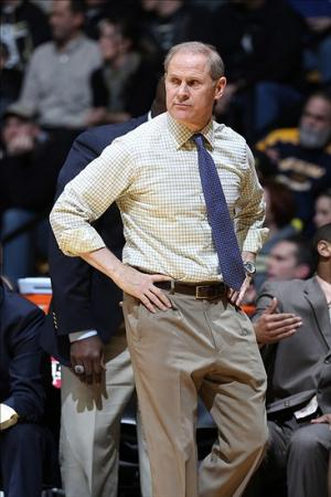 Feb 26, 2014; West Lafayette, IN, USA; Michigan Wolverines coach John Beilein coaching on the sidelines against the Purdue Boilermakers at Mackey Arena. Michigan defeats Purdue 77-76 in overtime. Mandatory Credit: Brian Spurlock-USA TODAY Sports