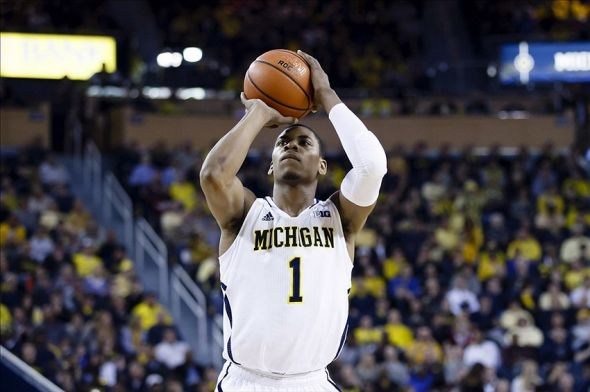 Mar 8, 2014; Ann Arbor, MI, USA; Michigan Wolverines forward Glenn Robinson III (1) shoots a free throw against the Indiana Hoosiers in the first half at Crisler Arena. Mandatory Credit: Rick Osentoski-USA TODAY Sports
