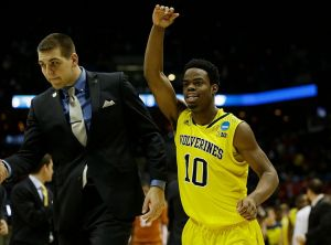 Mar 22, 2014; Milwaukee, WI, USA; Michigan Wolverines guard Derrick Walton Jr. (10) runs off the court after defeating the Texas Longhorns during the third round of the 2014 NCAA Tournament at BMO Harris Bradley Center. Michigan defeated Texas 79-65. Mandatory Credit: Jeff Hanisch-USA TODAY Sports