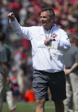 Apr 12, 2014; Columbus, OH, USA; Ohio State Buckeyes head coach Urban Meyer gestures from the field prior to the the Ohio State Buckeyes Spring Game at Ohio Stadium. The Scarlet team won 17-7. Mandatory Credit: Greg Bartram-USA TODAY Sports