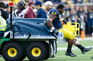 Oct 5, 2013; Ann Arbor, MI, USA; Michigan Wolverines defensive tackle Ondre Pipkins (56) is carted off the field against the Minnesota Golden Gophers at Michigan Stadium. Mandatory Credit: Rick Osentoski-USA TODAY Sports