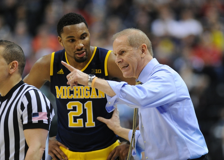 Mar 12, 2016; Indianapolis, IN, USA; Michigan Wolverine head coach John Beilein (R) talks with Michigan Wolverine guard Zak Irvin (21) during a timeout against the Purdue Boilermakers during the Big Ten Conference tournament at Bankers Life Fieldhouse. Mandatory Credit: Thomas J. Russo-USA TODAY Sports