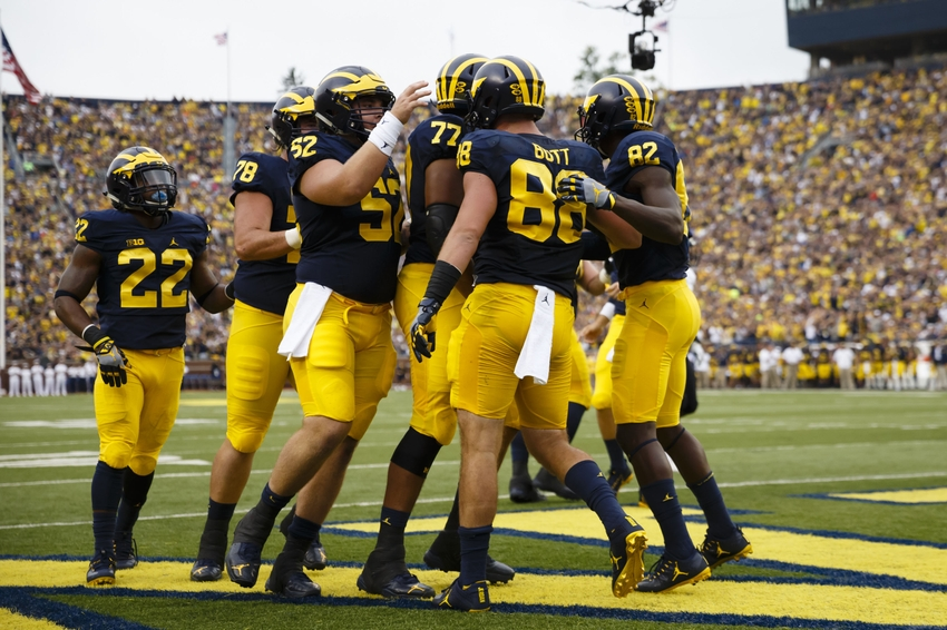Sep 10, 2016; Ann Arbor, MI, USA; Michigan Wolverines tight end Jake Butt (88) receives congratulations from teammates after scoring a touchdown in the first quarter against the UCF Knights at Michigan Stadium. Mandatory Credit: Rick Osentoski-USA TODAY Sports