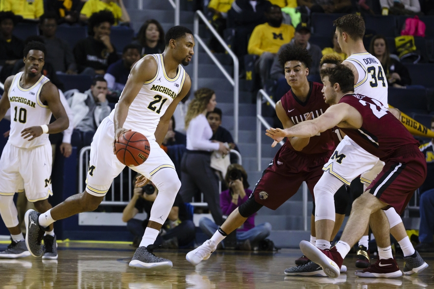 Nov 13, 2016; Ann Arbor, MI, USA; Michigan Wolverines guard Zak Irvin (21) dribbles during the second half against the IUPUI Jaguars at Crisler Center. Michigan won 77-65. Mandatory Credit: Rick Osentoski-USA TODAY Sports