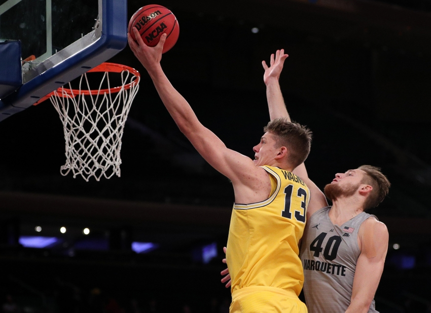 Nov 17, 2016; New York, NY, USA; Michigan Wolverines forward Moritz Wagner (13) attempts a lay up as Marquette Golden Eagles center Luke Fischer (40) defends during the second half at Madison Square Garden. Michigan won, 79-61. Mandatory Credit: Vincent Carchietta-USA TODAY Sports
