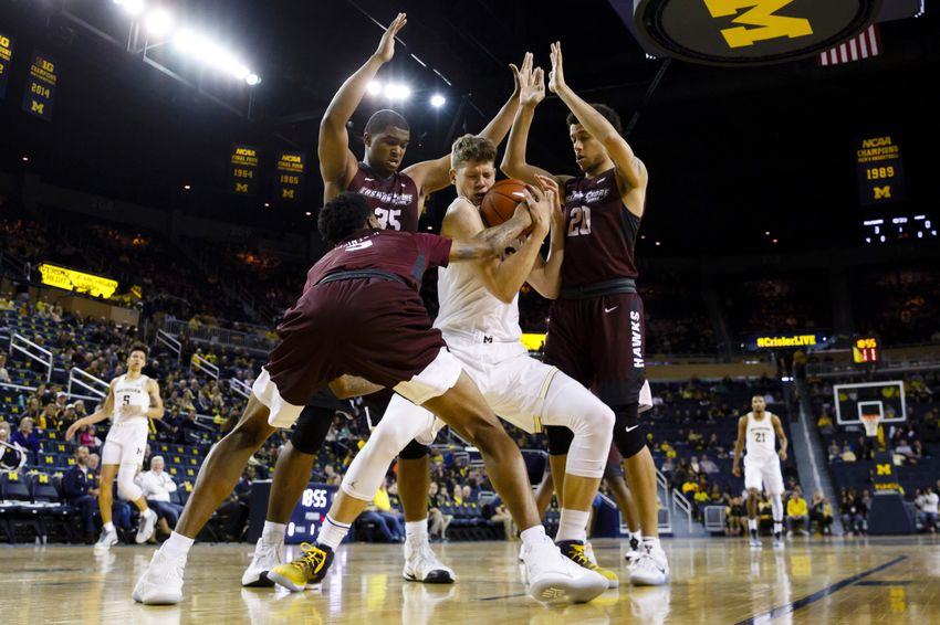 Dec 17, 2016; Ann Arbor, MI, USA; Michigan Wolverines forward Moritz Wagner (13) fights for the ball with Maryland-Eastern Shore Hawks guard Logan McIntosh (3) forward Isaac Taylor (35) and guard Dontae Caldwell (20) in the first half at Crisler Center. Mandatory Credit: Rick Osentoski-USA TODAY Sports