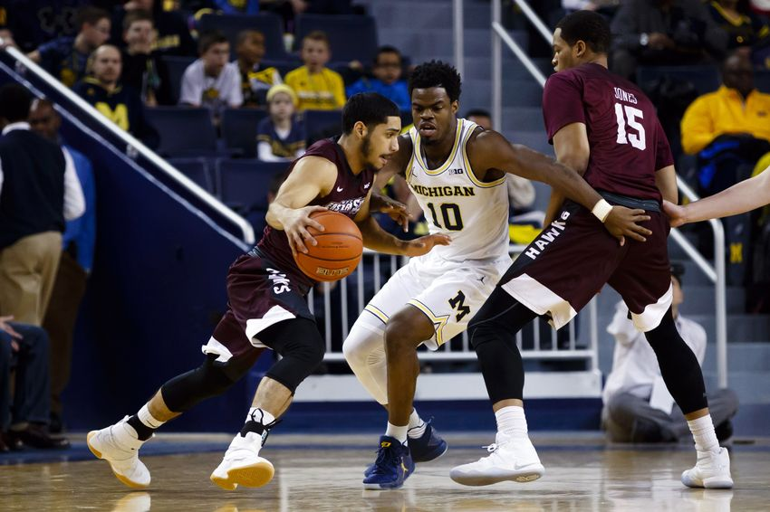 Dec 17, 2016; Ann Arbor, MI, USA; Maryland-Eastern Shore Hawks guard Thomas Rivera (2) dribbles defended by Michigan Wolverines guard Derrick Walton Jr. (10) in the first half at Crisler Center. Mandatory Credit: Rick Osentoski-USA TODAY Sports