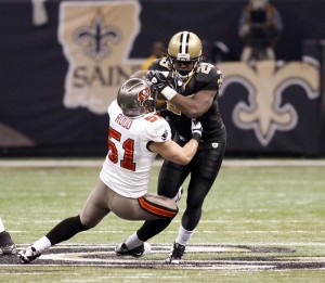 New Orleans Saints running back Chris Ivory (29) is stopped by Tampa Bay Buccaneers linebacker Barrett Ruud (51) during first half action at the Louisiana Superdome in New Orleans. PHOTO COURTESY: UPIA.J. Sisco