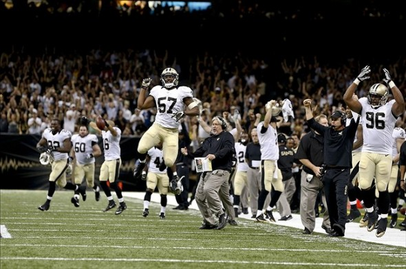 Sep 8, 2013; New Orleans, LA, USA; The New Orleans Saints sideline erupts following a fourth down interception against the Atlanta Falcons during a game at the Mercedes-Benz Superdome. The Saints defeated the Falcons 23-17. Mandatory Credit: Derick E. Hingle-USA TODAY Sports