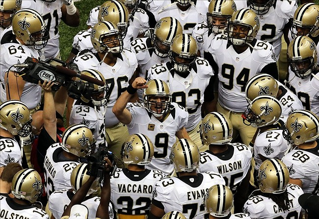 Sep 22, 2013; New Orleans, LA, USA; New Orleans Saints quarterback Drew Brees (9) before their game against the Arizona Cardinals at Mercedes-Benz Superdome. Mandatory Credit: Chuck Cook-USA TODAY Sports
