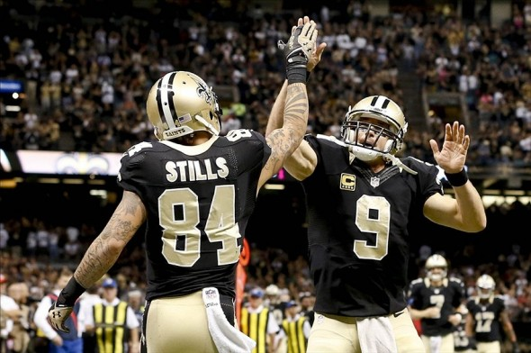 Oct 27, 2013; New Orleans, LA, USA; New Orleans Saints quarterback Drew Brees (9) and wide receiver Kenny Stills (84) celebrates after a touchdown against the Buffalo Bills during the second half of a game at Mercedes-Benz Superdome. The Saints defeated the Bills 35-17. Mandatory Credit: Derick E. Hingle-USA TODAY Sports