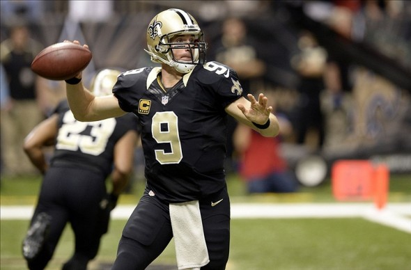 Nov 17, 2013; New Orleans, LA, USA; New Orleans Saints quarterback Drew Brees (9) rolls out to pass against the San Francisco 49ers during the first quarter at Mercedes-Benz Superdome. Mandatory Credit: John David Mercer-USA TODAY Sports