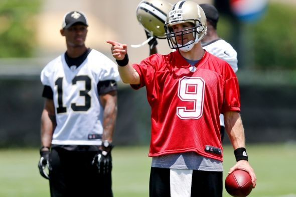 May 29, 2014; Metairie, LA, USA; New Orleans Saints quarterback Drew Brees (9) during organized team activities at the New Orleans Saints Training Facility. Mandatory Credit: Derick E. Hingle-USA TODAY Sports