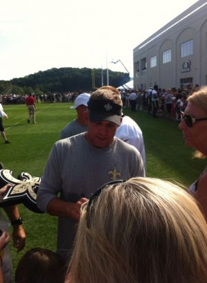 Saints head coach Sean Payton signing autographs at the Greenbrier Picnic With the Saints; July 26, 2014