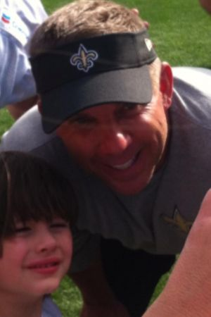Saints coach Sean Paton posing with a young fan at the Greebrier Picnic With the Saints; July 26, 2014