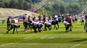 Saints TE Jimmy Graham (far right) lined up in the slot as QB Drew Brees calls a play during Walk-Trough Practice; July 26, 2014