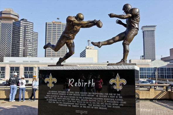 """The """"Rebirth: statue outside the Superdome depicting Steve Gleason's famous blocked punt (Photo courtesy of WordPress.com)"""