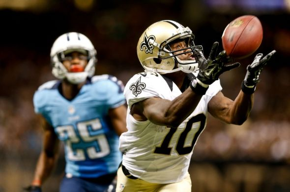 Aug 15, 2014; New Orleans, LA, USA; New Orleans Saints wide receiver Brandin Cooks (10) reaches out for a pass as Tennessee Titans cornerback Blidi Wreh-Wilson (25) defends during second half of a preseason game at Mercedes-Benz Superdome. The New Orleans Saints defeated the Tennessee Titans 31-24. Mandatory Credit: Derick E. Hingle-USA TODAY Sports