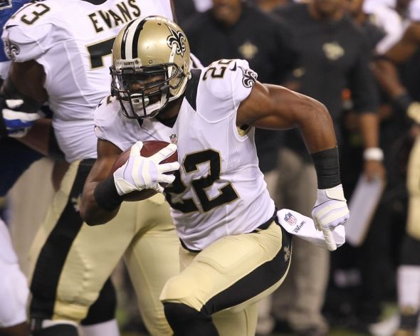 Aug 23, 2014; Indianapolis, IN, USA; New Orleans Saints running back Mark Ingram (22) runs the ball during the first quarter against the Indianapolis Colts at Lucas Oil Stadium. Mandatory Credit: Pat Lovell-USA TODAY Sports