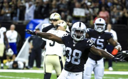 Sep 11, 2016; New Orleans, LA, USA; Oakland Raiders strong safety T.J. Carrie (38) celebrates after New Orleans Saints kicker Will Lutz (3) misses a 61 yard field goal attempt as time expires during the fourth quarter of a game at the Mercedes-Benz Superdome. The Raiders defeated the Saints 35-34. Mandatory Credit: Derick E. Hingle-USA TODAY Sports
