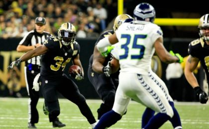Oct 30, 2016; New Orleans, LA, USA; New Orleans Saints running back Tim Hightower (34) runs against the Seattle Seahawks during the second quarter of a game at the Mercedes-Benz Superdome. Mandatory Credit: Derick E. Hingle-USA TODAY Sports