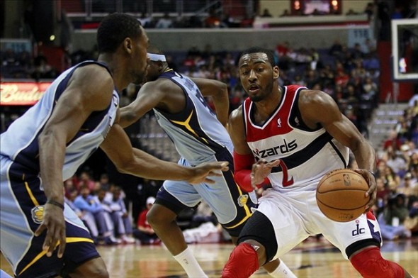 Mar 25, 2013; Washington, DC, USA; Washington Wizards point guard John Wall (2) dribbles the ball against Memphis Grizzlies shooting guard Tony Allen (9) in the second quarter at Verizon Center. The Wizards won 107- 94. Mandatory Credit: Geoff Burke-USA TODAY Sports