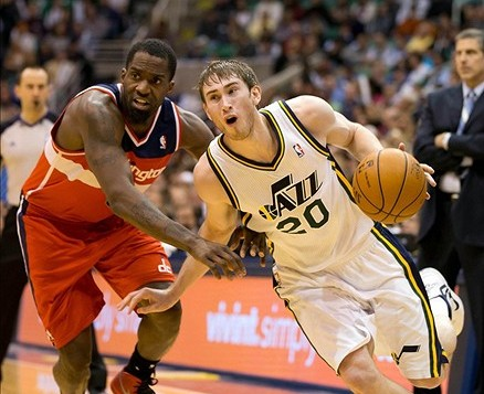 Jan 23, 2013; Salt Lake City, UT, USA; Utah Jazz shooting guard Gordon Hayward (20) dribbles around Washington Wizards small forward Martell Webster (9) during the second half at EnergySolutions Arena. The Jazz won 92-88. Mandatory Credit: Russ Isabella-USA TODAY Sports