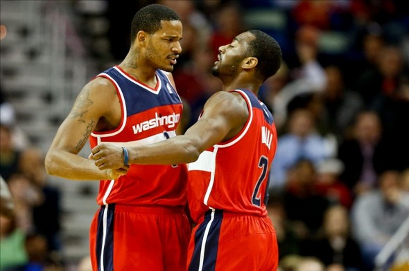 Jan 8, 2014; New Orleans, LA, USA; Washington Wizards small forward Trevor Ariza (1) and point guard John Wall (2) celebrate after a basket against the New Orleans Pelicans during the third quarter of a game at the New Orleans Arena. Mandatory Credit: Derick E. Hingle-USA TODAY Sports