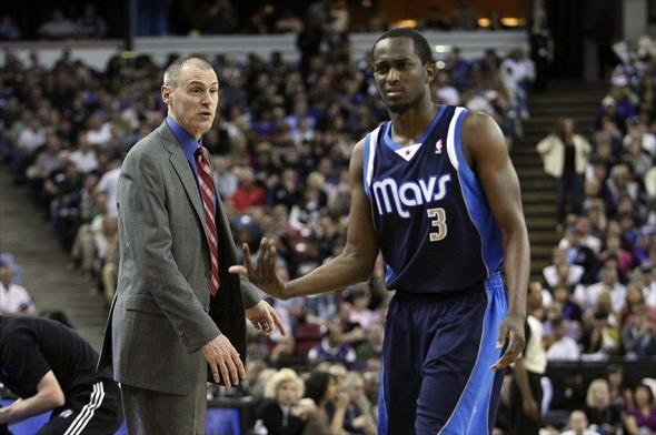 March 09, 2012; Sacramento, CA, USA; Dallas Mavericks head coach Rick Carlisle speaks with guard Rodrigue Beaubois (3) as he returns to the bench against the Sacramento Kings during the fourth quarter at Power Balance Pavilion. The Sacramento Kings defeated the Dallas Mavericks 110-97. Mandatory Credit: Kelley L Cox-USA TODAY Sports