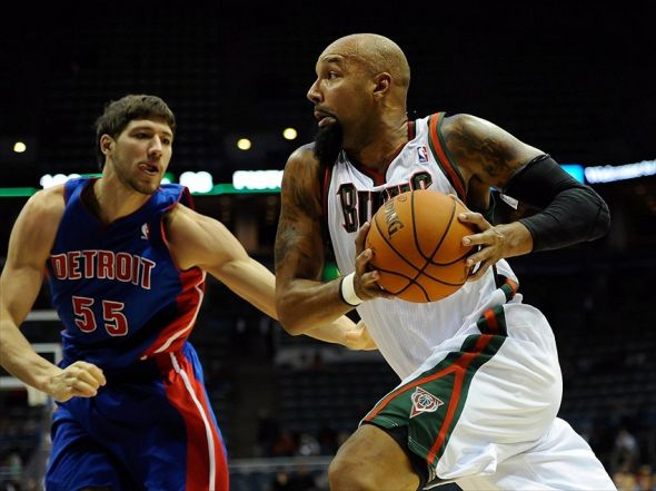 Oct 13, 2012; Milwaukee, WI, USA; Milwaukee Bucks forward Drew Gooden (0) drives past Detroit Pistons center Viacheslav Kravtsov (55) at the Bradley Center. Mandatory Credit: Benny Sieu-USA TODAY Sports