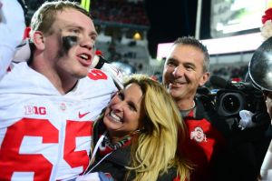 Nov 8, 2014; East Lansing, MI, USA; Ohio State Buckeyes offensive lineman Pat Elflein (65) celebrates with Shelly Meyer and Urban Meyer after defeating the Michigan State Spartans 49-37 at Spartan Stadium. Mandatory Credit: Andrew Weber-USA TODAY Sports