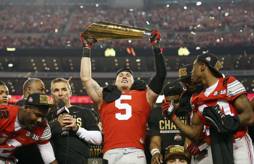 Jan 12, 2015; Arlington, TX, USA; Ohio State Buckeyes tight end Jeff Heuerman (5) hoists the College Football Playoff trophy after the game against Oregon Ducks in the 2015 CFP National Championship Game at AT&T Stadium. Mandatory Credit: Matthew Emmons-USA TODAY Sports