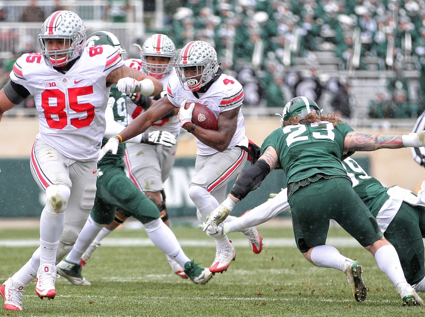 Nov 19, 2016; East Lansing, MI, USA; Ohio State Buckeyes running back Curtis Samuel (4) runs the ball against the Michigan State Spartans during the first half of a game at Spartan Stadium. Mandatory Credit: Mike Carter-USA TODAY Sports