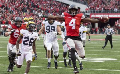 Nov 26, 2016; Columbus, OH, USA; Ohio State Buckeyes running back Curtis Samuel (4) scores the winning touchdown in the second overtime under pursuit from Michigan Wolverines cornerback Jourdan Lewis (26) at Ohio Stadium. Ohio State won the game 30-27 in double overtime.Mandatory Credit: Greg Bartram-USA TODAY Sports