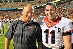 Oct 5, 2013; Knoxville, TN, USA; Georgia Bulldogs head coach Mark Richt walks off the field with Georgia quarterback Aaron Murray (11) after defeating the Tennessee Volunteers 34-31during overtime at Neyland Stadium. Mandatory Credit: Jim Brown-USA TODAY Sports