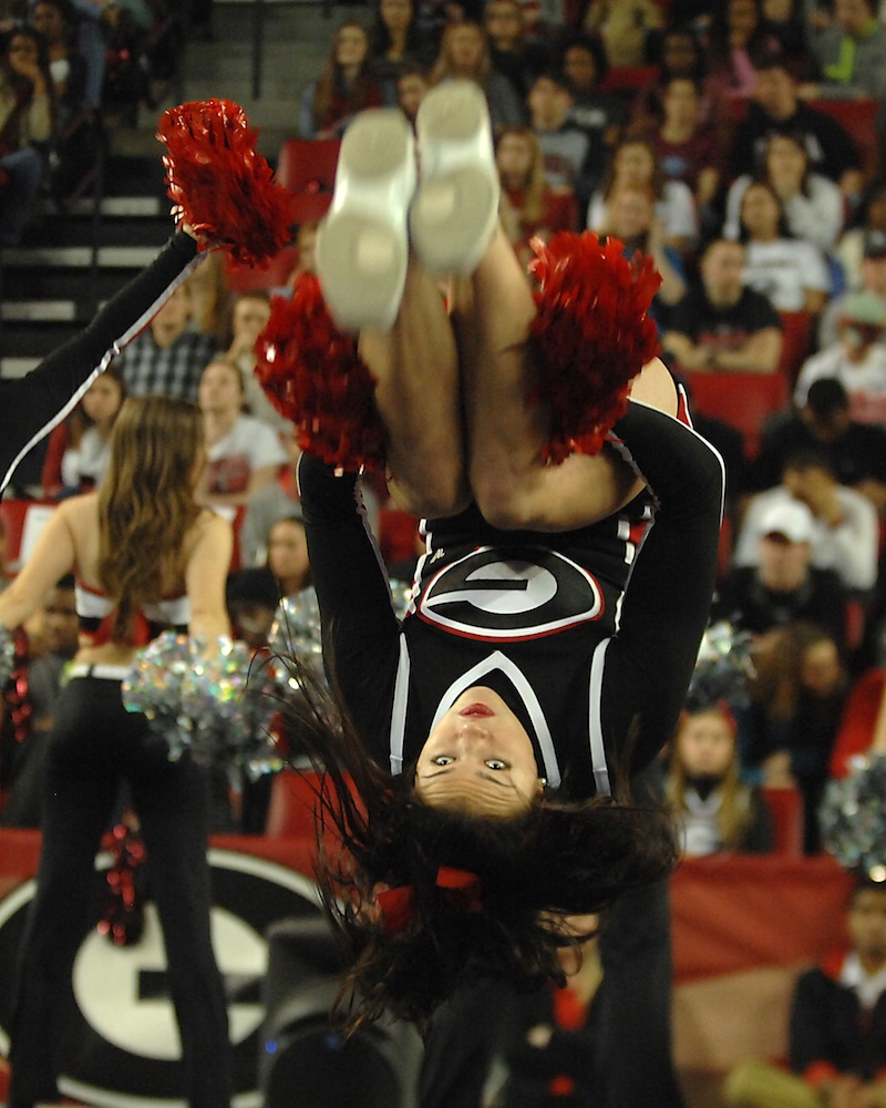 UGA Cheerleader, Taylor Turnipseed, does a back flip.