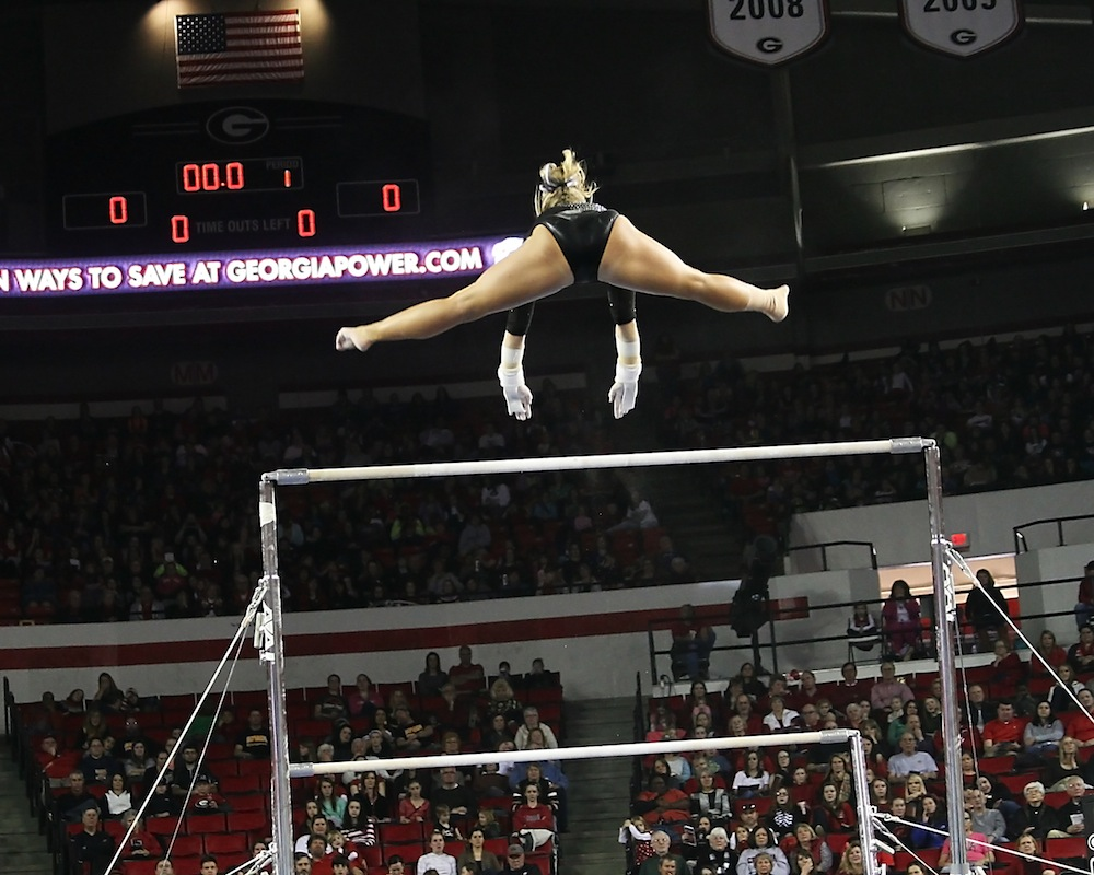 Flying high on the uneven bars.