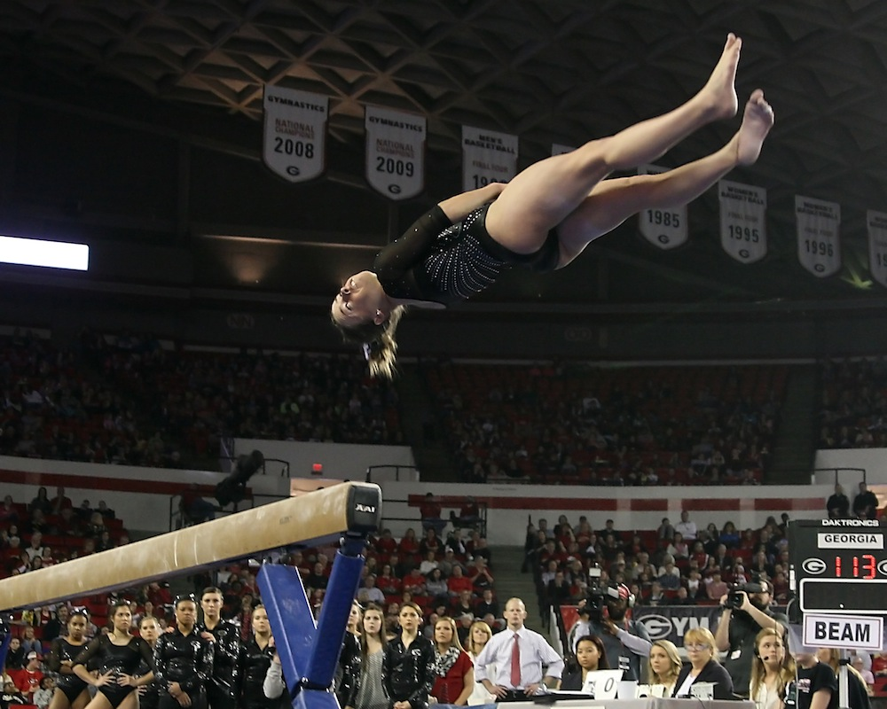 Balance beam dismount by Mary Beth Box.