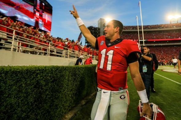 Sep 28, 2013; Athens, GA, USA; Georgia Bulldogs quarterback Aaron Murray (11) celebrates beating the LSU Tigers at Sanford Stadium. Georgia won 44-41. Mandatory Credit: Daniel Shirey-USA TODAY Sports