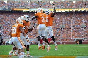 Aug 31, 2013; Knoxville, TN, USA; Tennessee Volunteers wide receiver Pig Howard (2) celebrates a touchdown catch against the Austin Peay Governors with running back Marlin Lane (15) at Neyland Stadium. Mandatory Credit: Randy Sartin-USA TODAY Sports